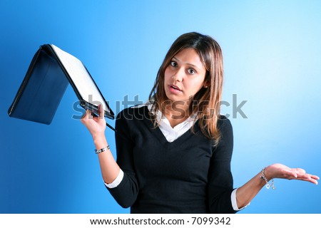 pretty latino girl throwing up hands in frustration - stock photo