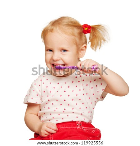 Pretty little child brushing teeth isolated on white background - stock photo