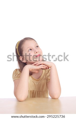 pretty little dreaming girl closeup - stock photo