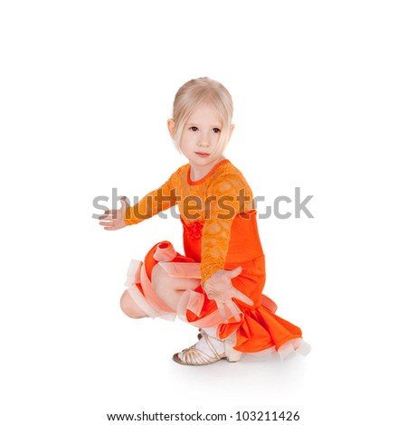 pretty little girl dancing in the ball dress