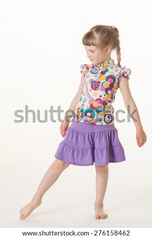 Pretty little girl dancing on white background - stock photo