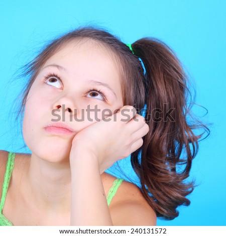 pretty little girl dreaming closeup - stock photo