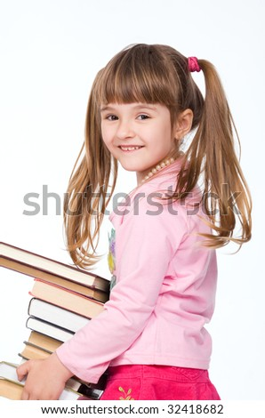 Pretty little girl holding stack of books - stock photo