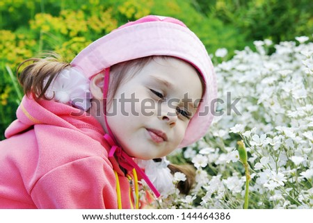 Pretty Little Girl in a Garden - stock photo