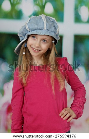 Pretty little girl in jeans cap - children beauty and fashion concept - stock photo