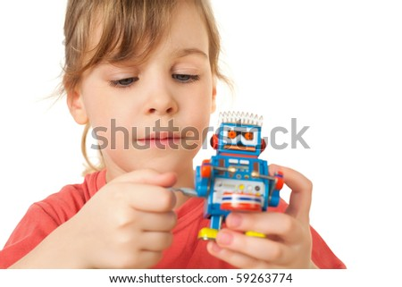 pretty little girl in red T-shirt plays with clockwork robot isolated on white background - stock photo