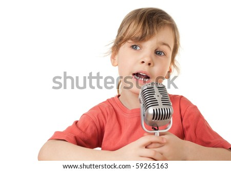 pretty little girl in red T-shirt sing in old style microphone isolated on white background, looking aside - stock photo