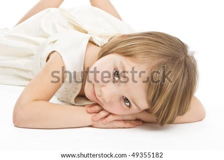 Pretty little girl in white dress on white background. - stock photo