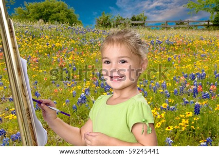 Pretty little girl painting bluebonnets on her easel. - stock photo