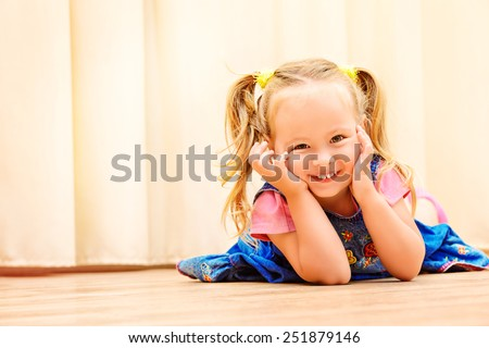 Pretty little girl playing at home. Happy childhood. - stock photo