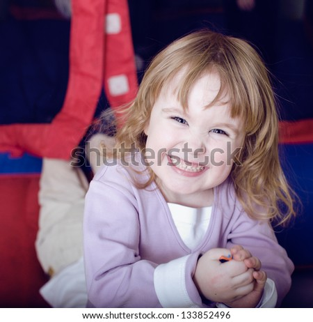 pretty little girl playing inside - stock photo