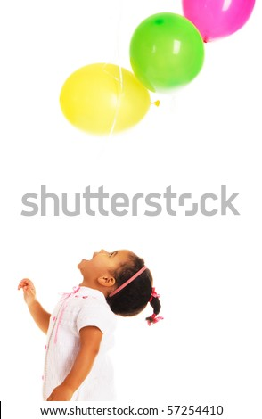 Pretty little girl playing with colorful balloons on white background - stock photo