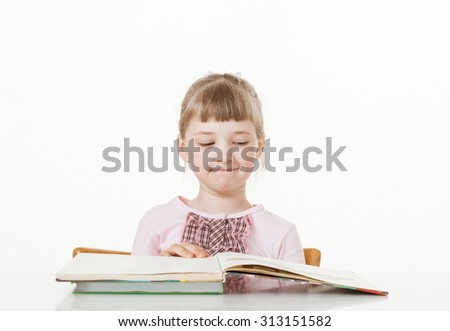 Pretty little girl reading a book, white background - stock photo