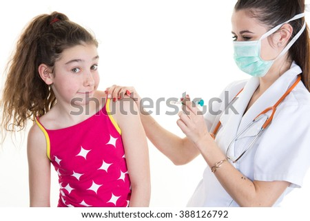 Pretty little girl receiving injection in doctor's office