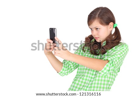 pretty little girl shooting by her mobile phone - stock photo