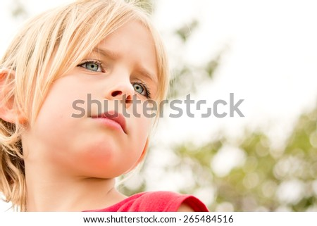 Pretty Little Girl Staring in Thought Outside - stock photo