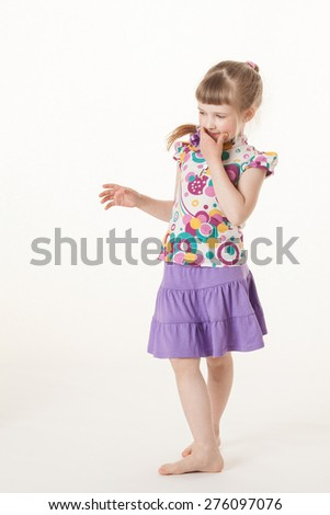 Pretty little girl thinking about something, white background - stock photo