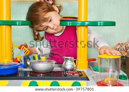 pretty Little Girl to play the cook - stock photo