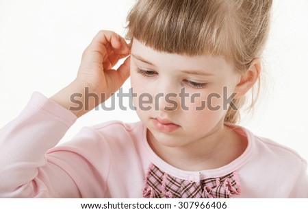 Pretty little girl touching her ear, white background - stock photo
