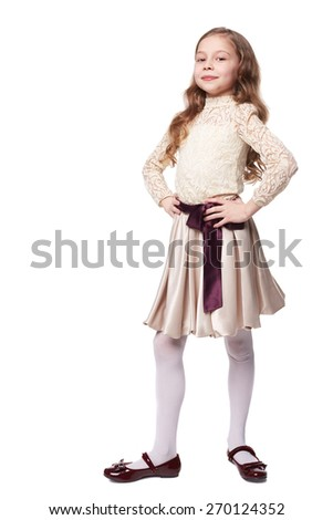 Pretty little girl wearing holiday dress isolated on white - stock photo