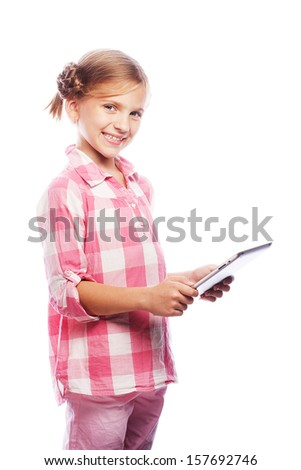 Pretty little girl with a Tablet PC. Isolated on white. - stock photo