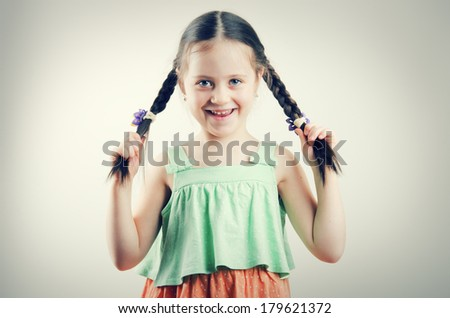 Pretty little girl with braids - stock photo