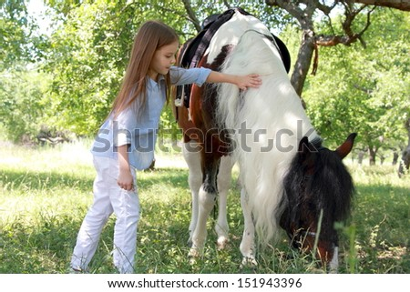 pretty little girl with horse - stock photo
