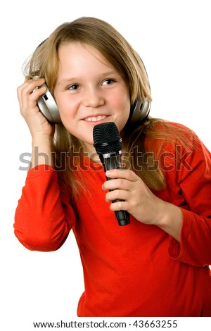 Pretty little girl with microphone and headphones  isolated over white - stock photo