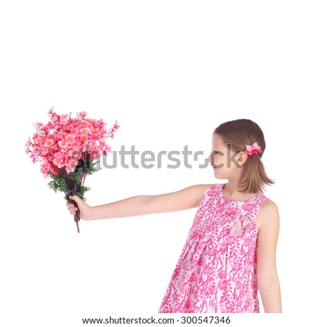 pretty little girl with the bunch of the summer flowers - stock photo