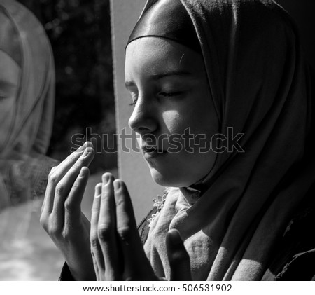 Pretty little muslim girl praying
