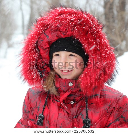 pretty little winter girl outdoors