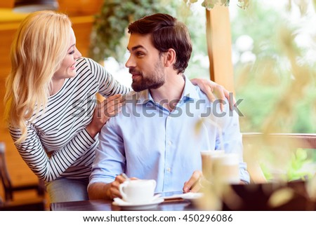 Pretty lovers having date in cafeteria - stock photo
