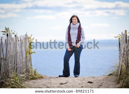 Pretty mid-adult woman at beach outdoors portrait - stock photo