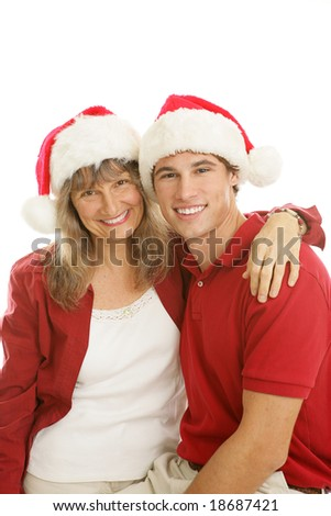 Pretty middle aged mom and her handsome college aged son, together for Christmas.  White background.
