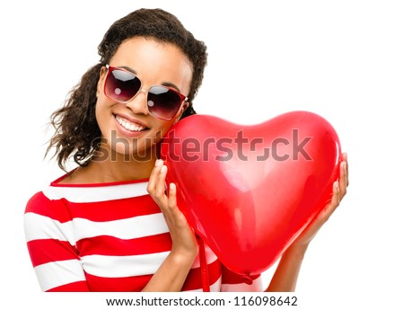 Pretty mixed race girl holding red heart balloon