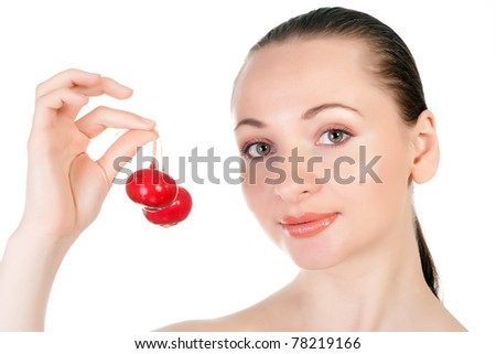 Pretty model holding radishes close to lips isolated on white in studio