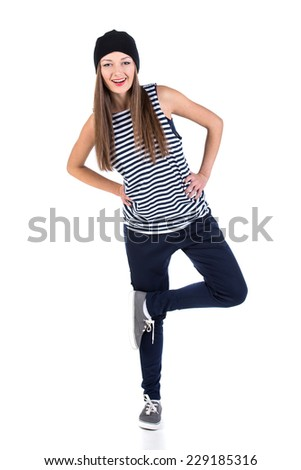 Pretty modern hip-hop style girl is dancing isolated on a white background. - stock photo