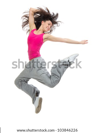 pretty modern slim hip-hop style teenage girl jumping dancing isolated on a white studio background