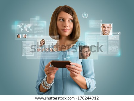 Pretty modern woman using her smartphone and virtual interface to communicate. Modern technology, internet and social media concept - stock photo