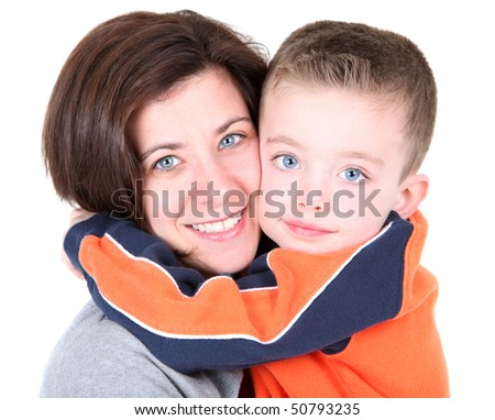 Pretty mom embracing cute son on white