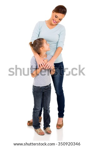 pretty mother standing with her cute daughter - stock photo