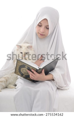 Pretty Muslim Girl and Cat with Holy Book of Quran Isolated on White Background - stock photo