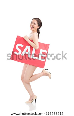 Pretty naked woman with big shopping bag - stock photo