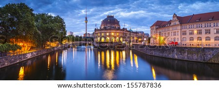 Pretty night time illuminations of the Museum Island in Berlin, Germany. - stock photo