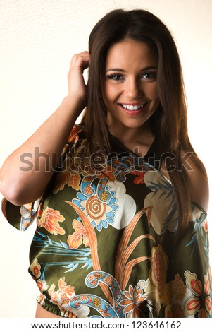 Pretty petite brunette in a colorful print blouse