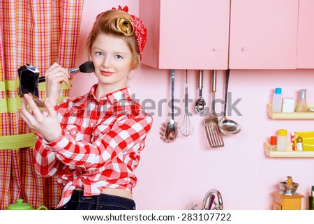 Pretty pin-up girl teenager smarten up on a pink kitchen. Beauty, youth fashion. Pin-up style. - stock photo