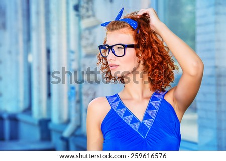 Pretty pin-up girl walking in the city. Beauty, fashion. - stock photo