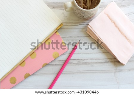 Pretty pink desktop accessories with room for copy over head view - stock photo