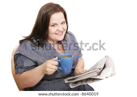 Pretty plus-sized businesswoman drinking coffee and reading the paper.  Isolated on white.