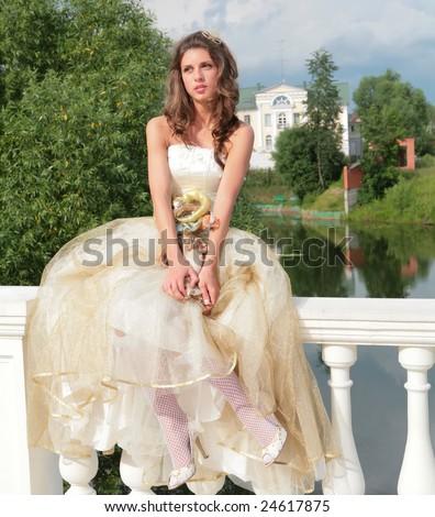 pretty princess in white-golden gown dreams of future - stock photo